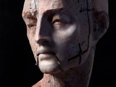 Christian Zucconi sculptures – Testa III (2014). Stone, iron and wax, cm 30 x 20,5 x 41