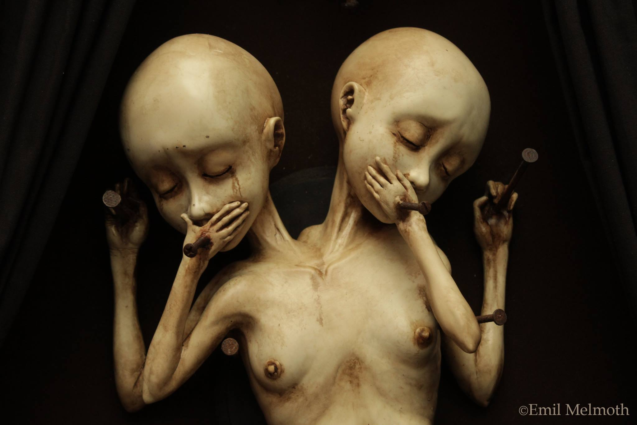 "Emil Melmoth, Sculptures – A closer look of ""Arcane"", the twin sisters that are the main attraction of a wicked and morbid sight, the urging desire of the pedophile mind disguise as one of a gentleman"